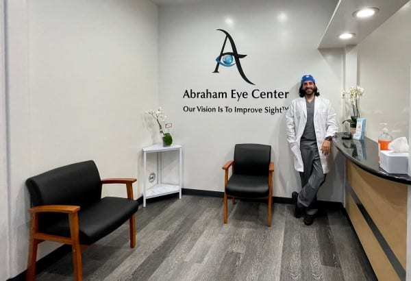 dr nathan abraham in white lab coat in office